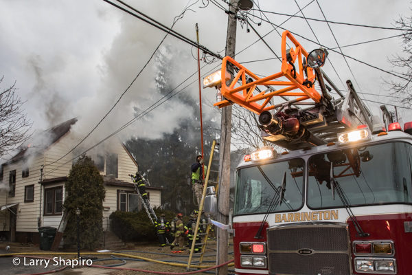 utility worker cuts power during house fire