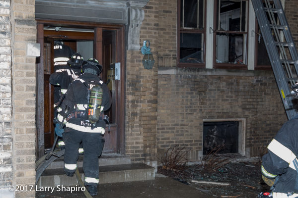 Firefighters enter building after fire