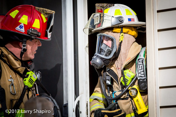 battalion chief confers with Firefighter at scene