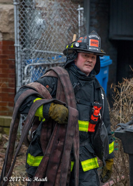probationary Firefighter carrying hose Chicago Fire Department candidate