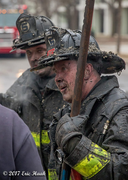 Chicago Firefighters with dirty faces after battling a fire