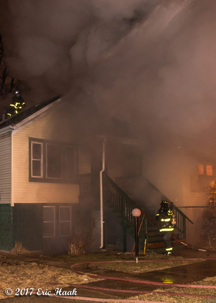 Chicago Firefighters battle a house fire at night