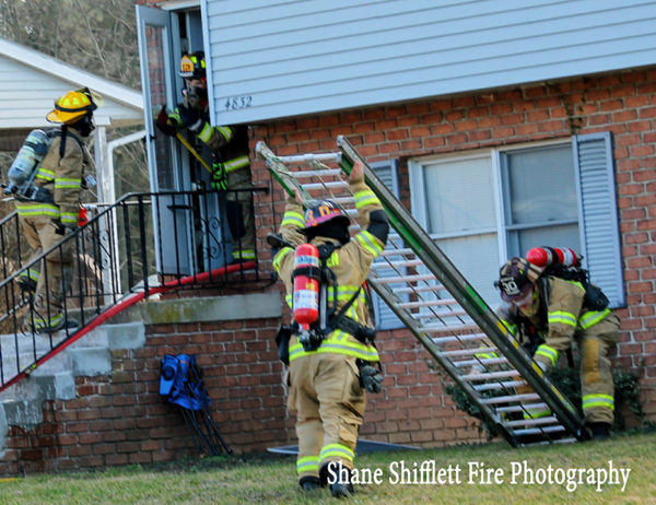 firefighters lower ground ladder