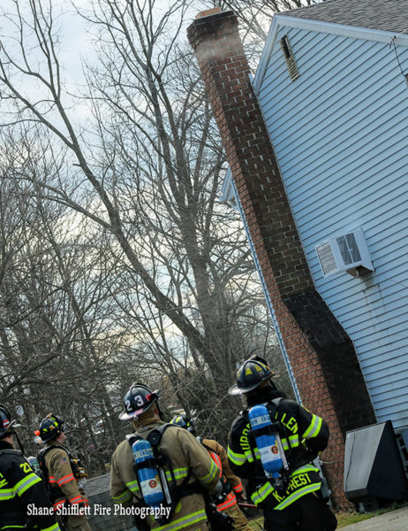 firefighters stand by at chimney fire