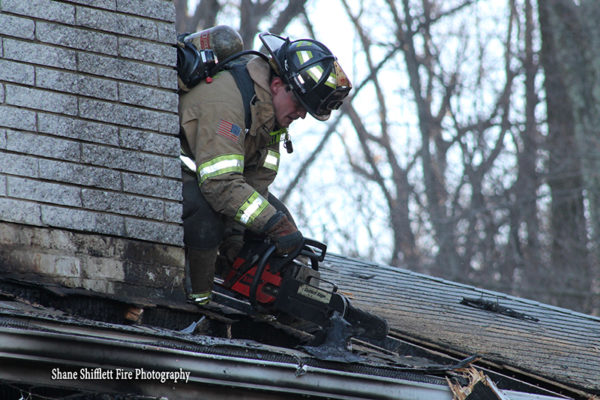 firefighter vents house roof