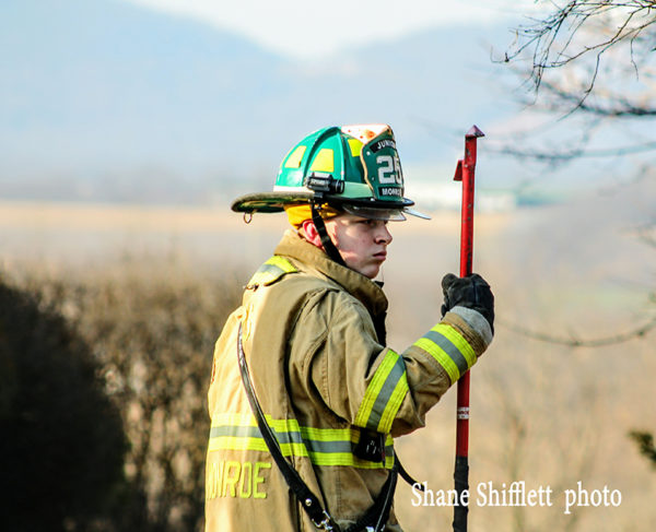 probationary firefighter at fire scene