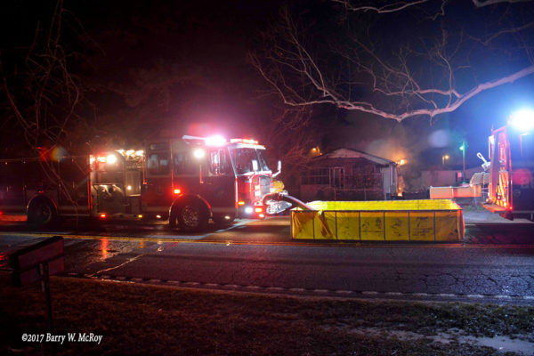 E-ONE fire engine drafts from portable tank at house fire