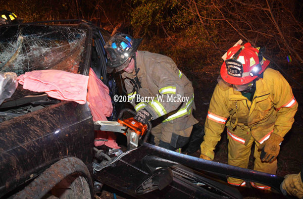 firefighters use Holmatro spreaders at vehicle extrication