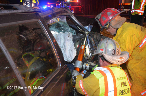 firefighters use Holmatro rams during crash extrication