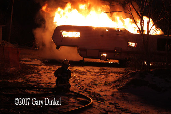 recreational trailer engulfed in fire