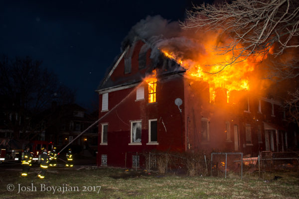heavy flames engulf house at night