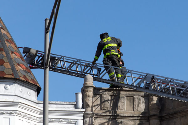firefighter climbing aerial ladder