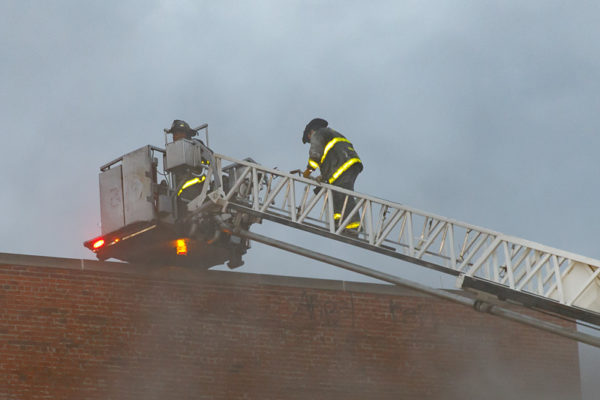 firefighters climb tower ladder