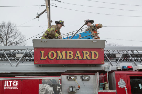 firefighters remove stokes basket from aerial