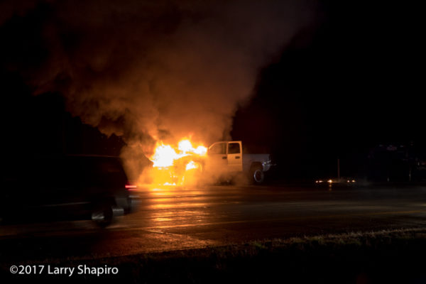pickup truck engulfed in flames on the highway