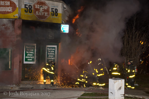 Chicago firefighters battle storefront fire