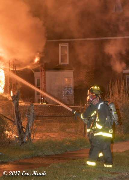 Detroit firefighters battle a house fire