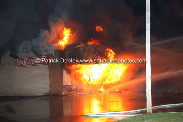 fire engulfs a commercial business at night