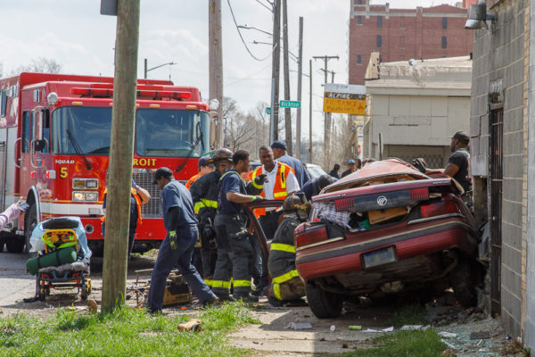 firefighters free crash victim from car