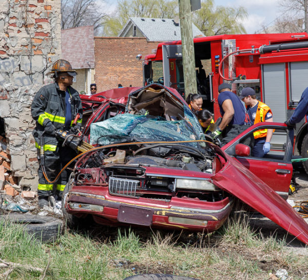 firefighters cut crash victim from car