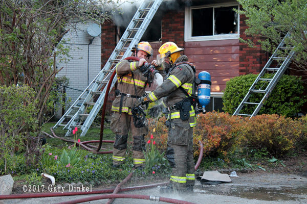 firefighters decon after battling house fire
