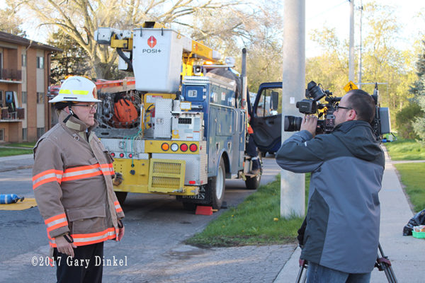 fire chief speaks to media at fire scene