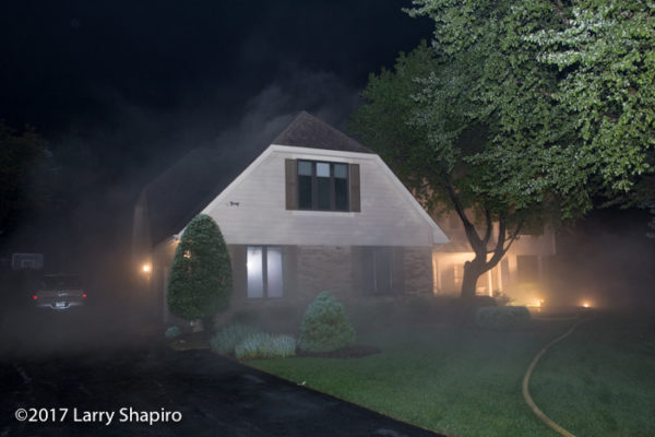 smoke pushes from house on fire