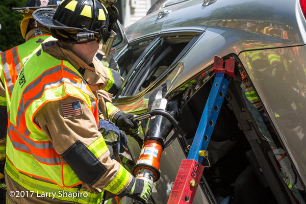 Firefighters free driver trapped in a car with Holmatro rescue tool