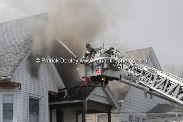 Stuffed tower ladder working during a house fire