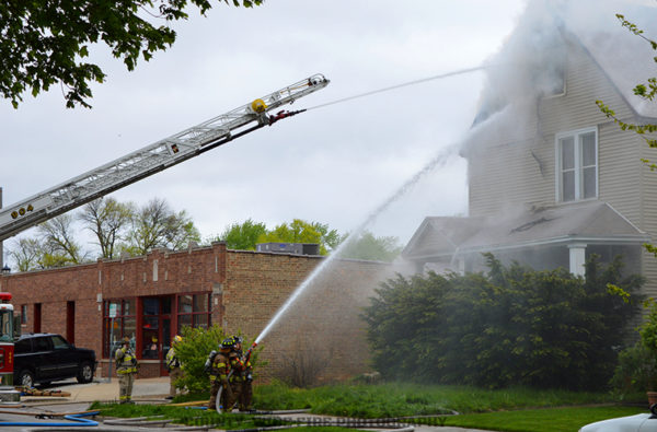 master streams directed at house fire