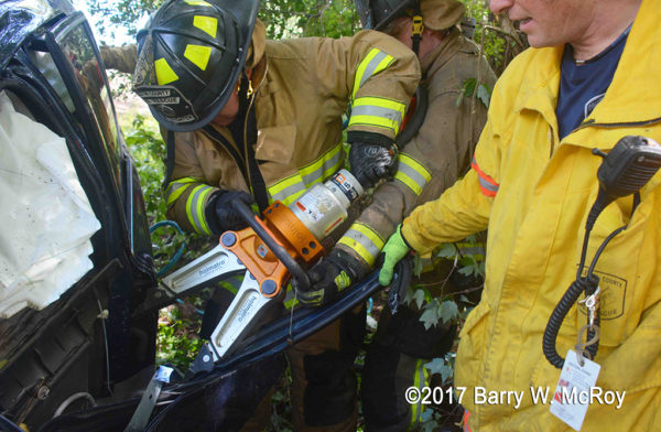 firefighters use Holmatro spreaders at crash site