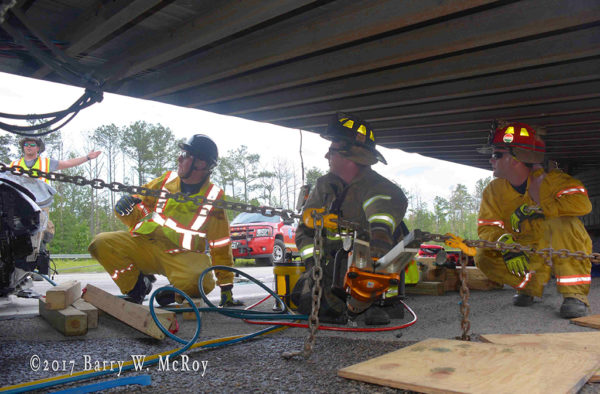 firefighters use Holmatro rescue tools at crash site