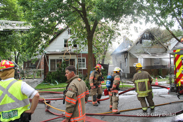 Kitchener firefighters at house fire scene
