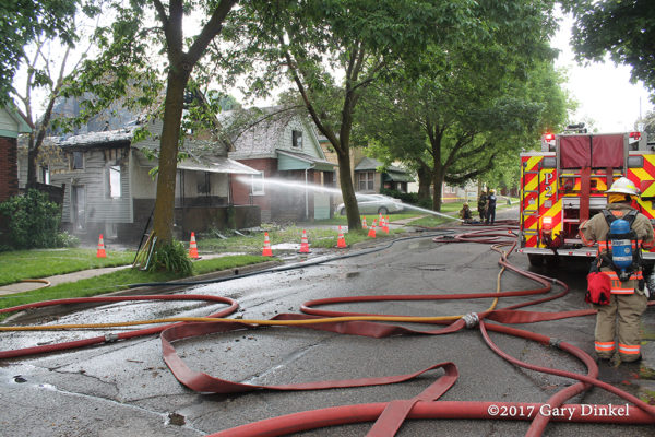 hose in the street after house fire
