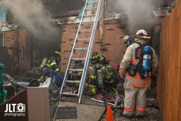 firefighters witness lines battle a fire