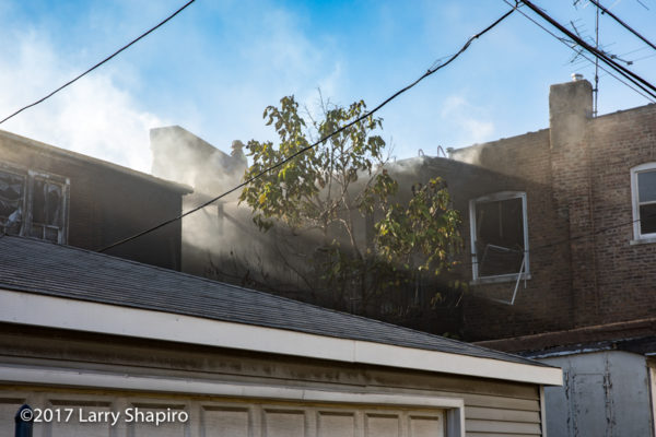 Firefighters battle fire on rear porches in Chicago
