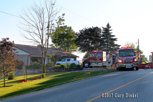 fire trucks at house fire in Wellesley Township ON