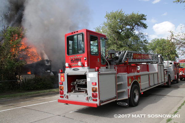Detroit firefighters battle fire in a dwelling