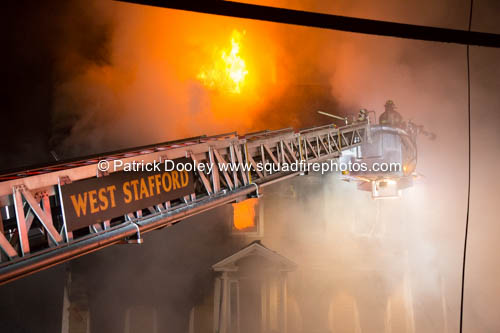 firefighters use a Sutphen tower ladder at a fire
