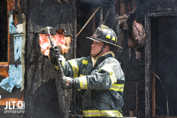 firefighter overhauls after a fire