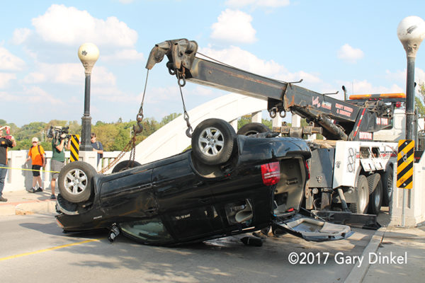 heavy wrecker rotator recovers a car