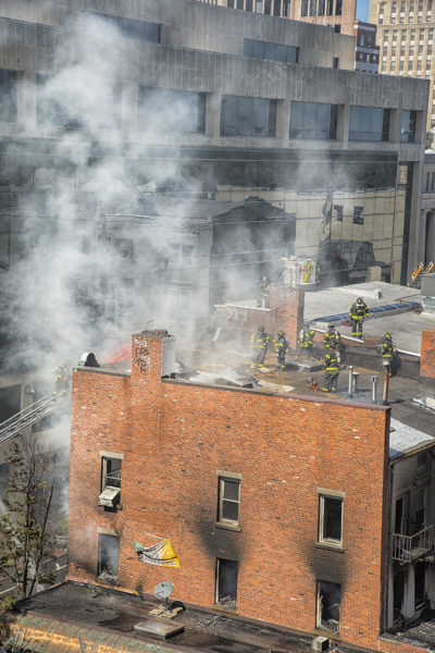 Firefighters vent apartment building roof