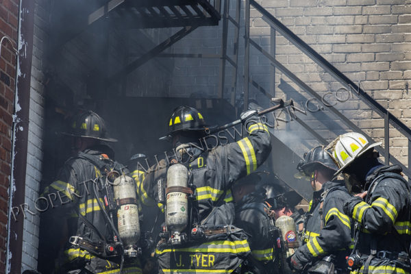 Firefighters overhaul after building fire