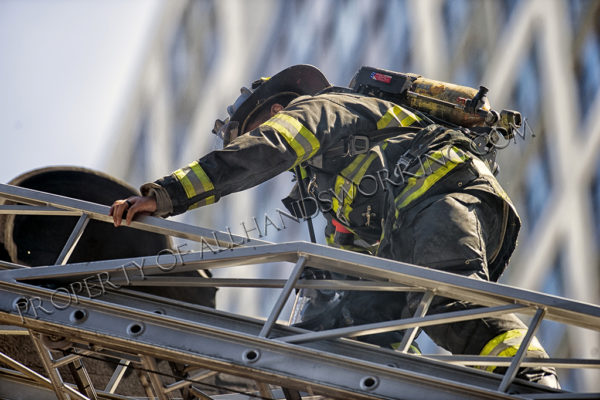 Firefighter climbs aerial ladder
