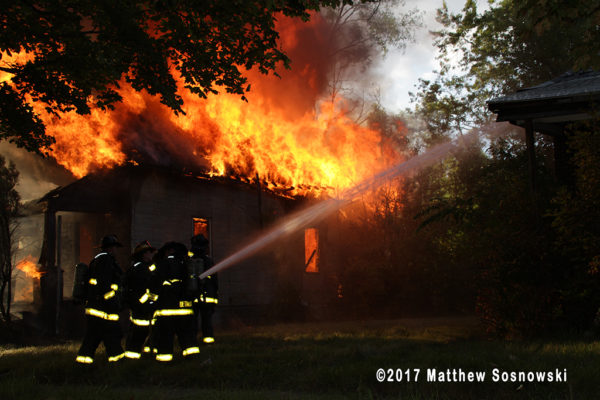 vacant dwelling fully engulfed in flames in Detroit