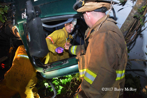 Firefighter-Paramedics treat victim trapped in a truck