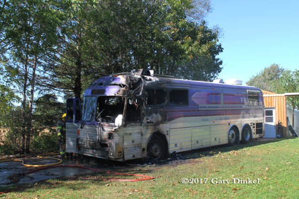 tour bus destroyed by fire