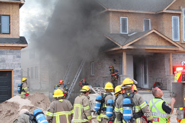 Kitchener firefighters battle house fire