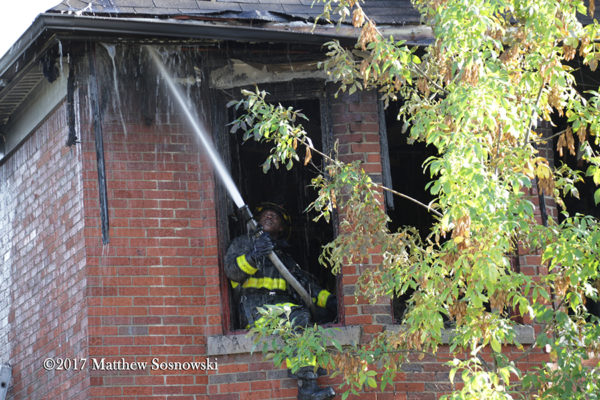 Firefighters overhaul after a fire