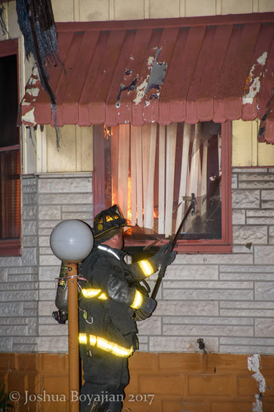 firefighter vents a window